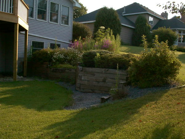 <b>Retaining wall</b> Before: Replace Timber Walls<br /><b>Color:</b> Keystone Slat Gray<br /><b>Style:</b> 3/4 setback; Round Planters<br /><b>Location:</b> Arden Hils<br /><b>Install Date:</b>July 2004